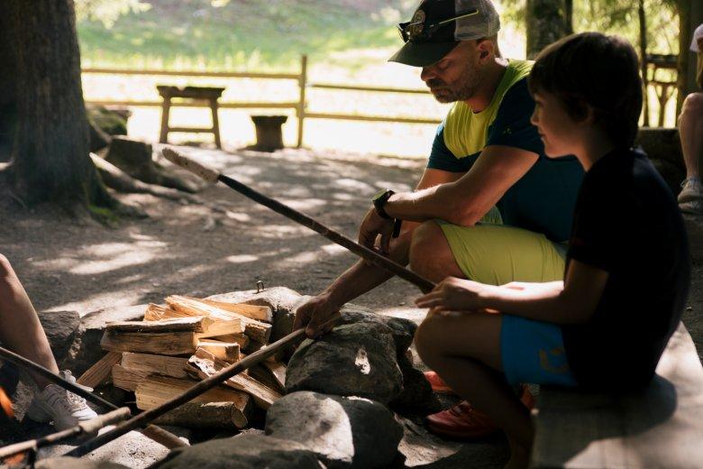 Baking homemade bread over an open fire.