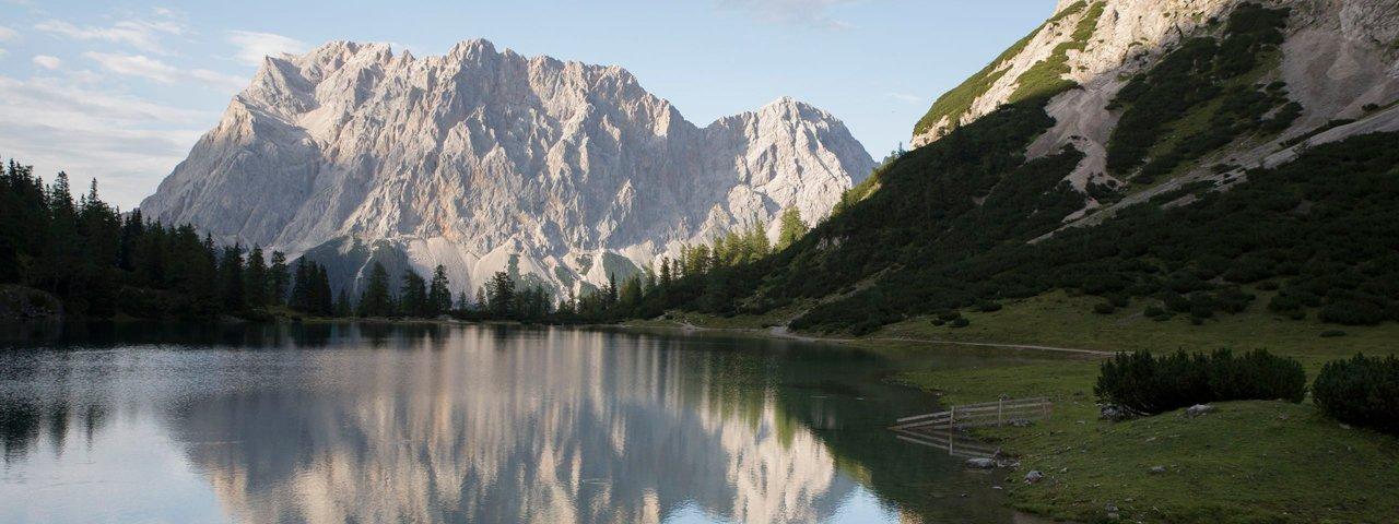 View from the Seebensee lake looking towards the Zugspitze mountain, © Tirol Werbung / Bert  Heinzelmeier