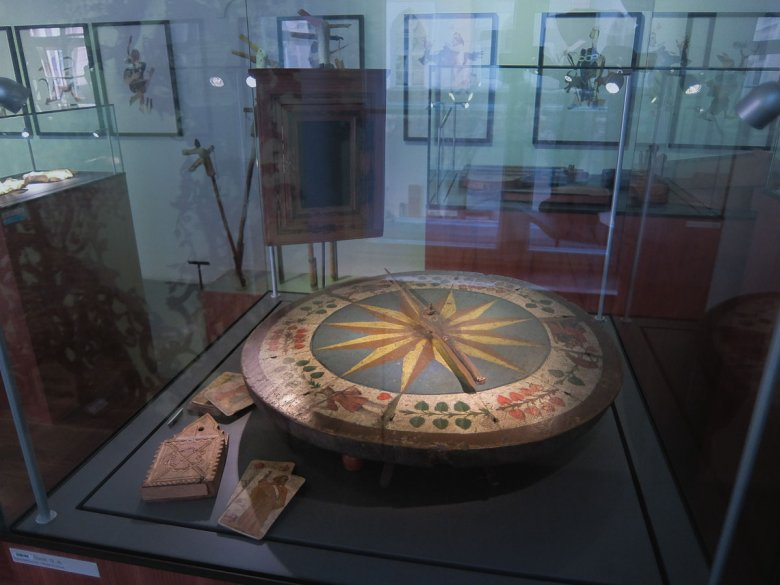 """A primitive form of roulette, the """"Drandl"""" wheel was a popular game in Tirol in the 19th century. Pictured in the rear is the board where the debts incurred by gamblers were listed."""