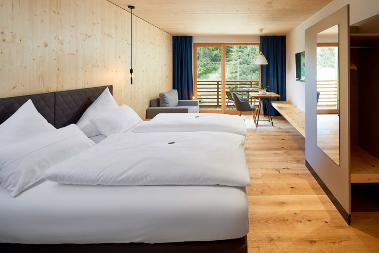 The crisp, minimalist rooms at Hotel LechZeit are breezy and comfortable. Photo Credit: Michael Huber