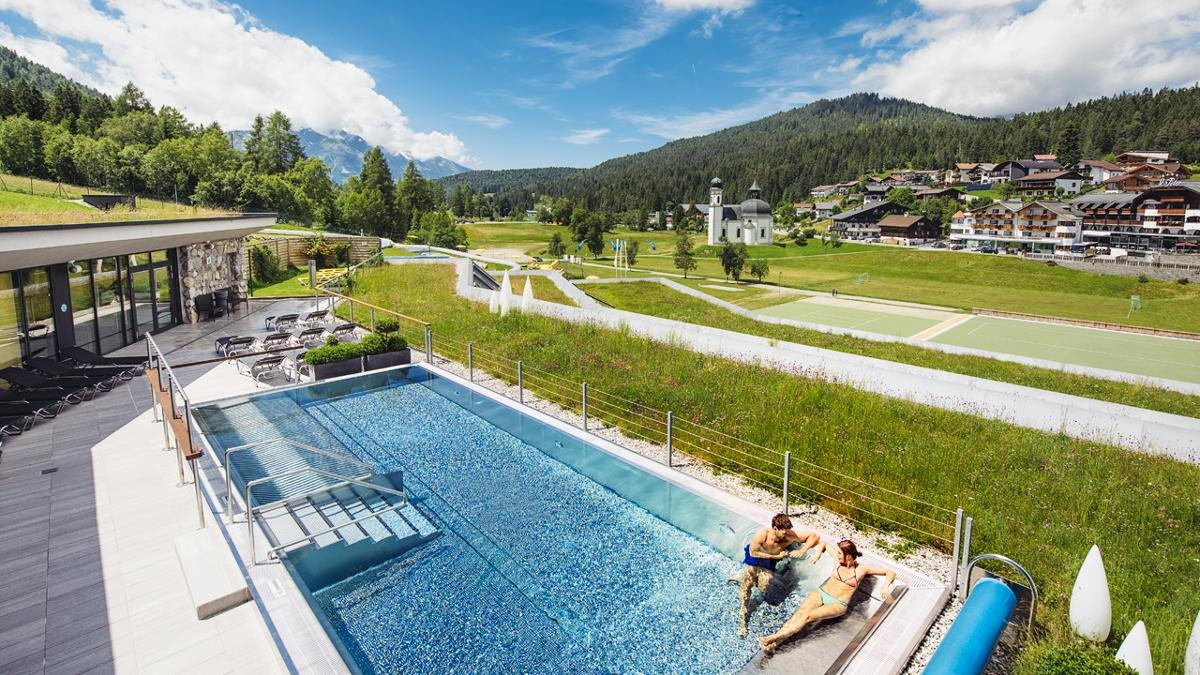 The Seefelder Sport- und Kongresszentrum includes a leisure centre with a 140m wildwater slide, a heated outdoor pool, underwater massage jets and a rock island with a fountain. There is also a large spa area with a selection of saunas., © Olympiaregion Seefeld, Andre Schönherr