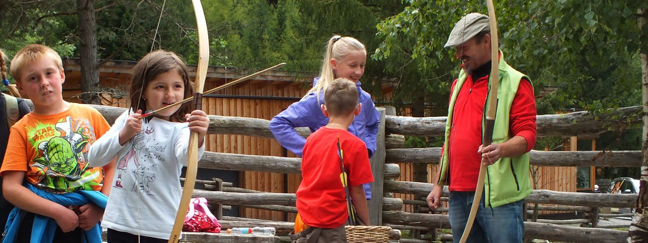Learn how to make and use bow and arrow at the Ötzi Survival Camp, © Ötzi-Dorf