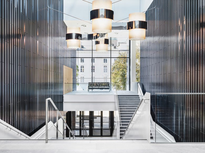 The Foyer is furnished with lamps by Werner Feiersinger and an artful sofa by Carola Dertnig.