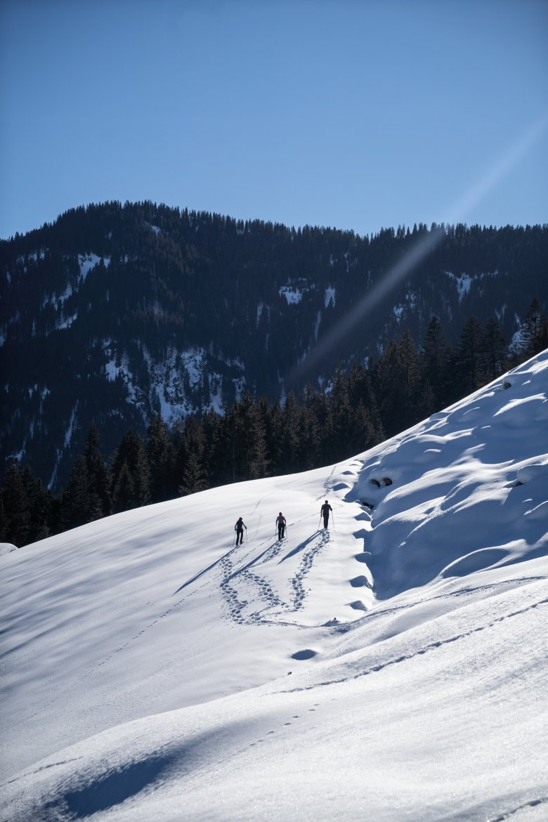 Footprints in the snow: Our author embarks on a snowshoe trip together with his wife Christelle and Carla.