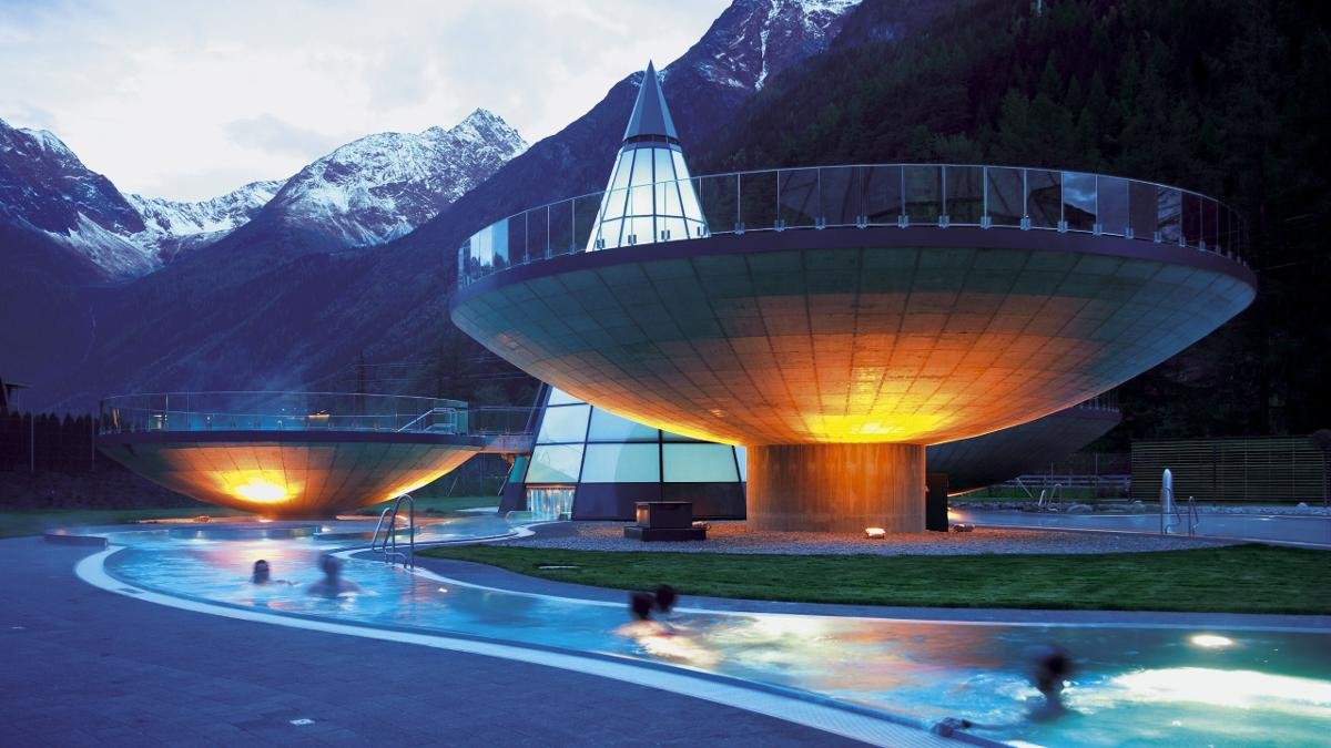 The surrounding mountain peaks are reflected in the surface of the glass tower which stands in the middle of three levitating bowls., © Ötztal Tourismus