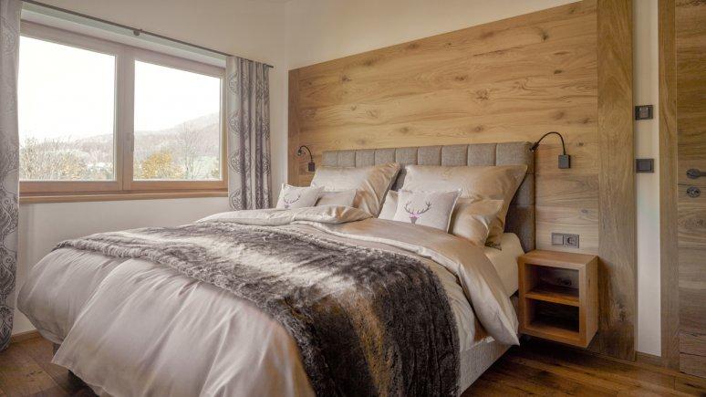 Bedroom in the Chalets Grosslehen, © Toni Niederwieser