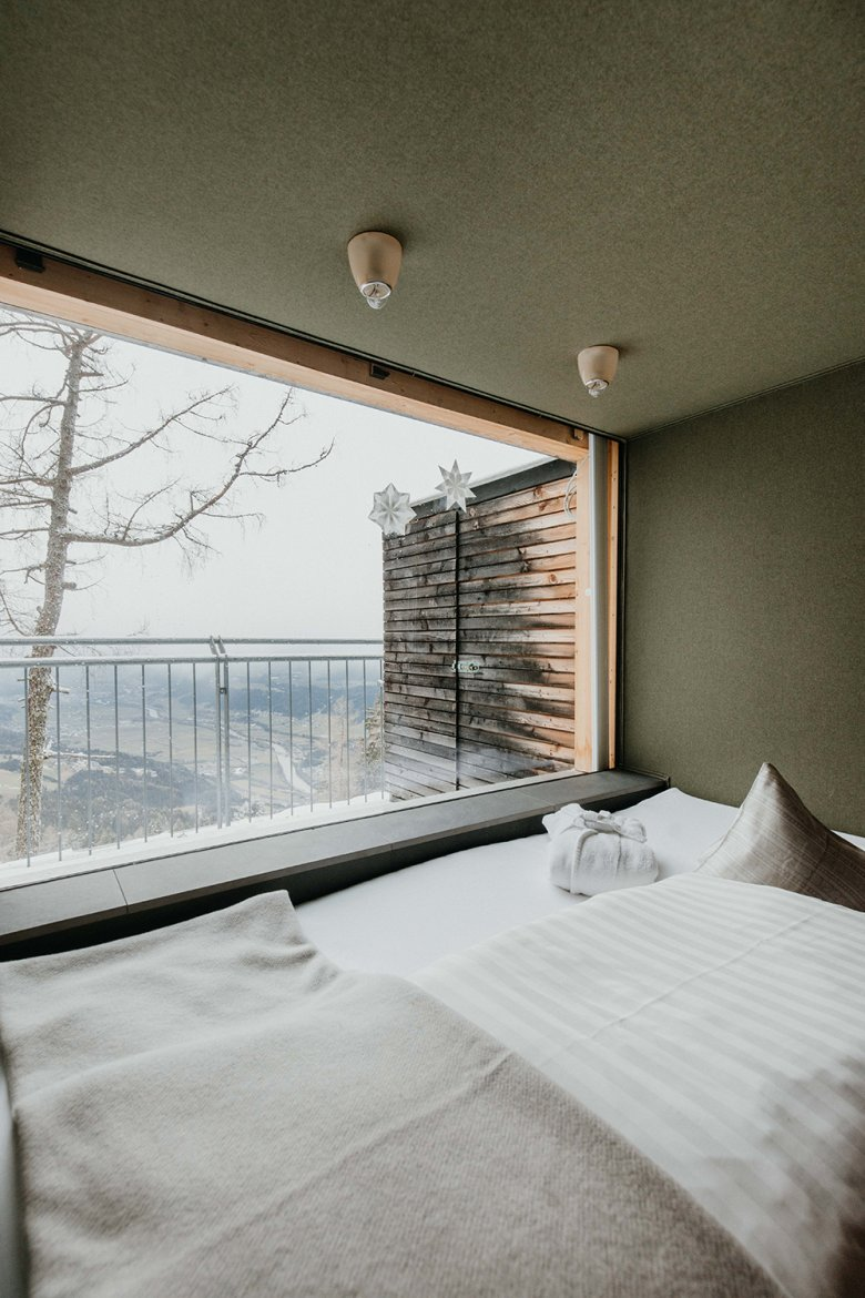 The rooms are decorated with natural materials and soothing pale tones, placing emphasis on the natural surroundings. Photo by Charly Schwarz