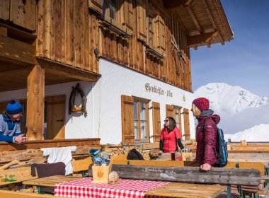 Relax and gather new strength on the sunny outdoor deck of Ehenbichl Alpine Pasture Hut