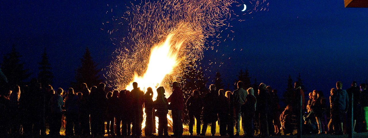 A spectacular Summer Solstice tradition is the bonfires that are lit annually in the Kitzbühel Alps, like the one atop Harschbichl Peak, © Gerhard Groger
