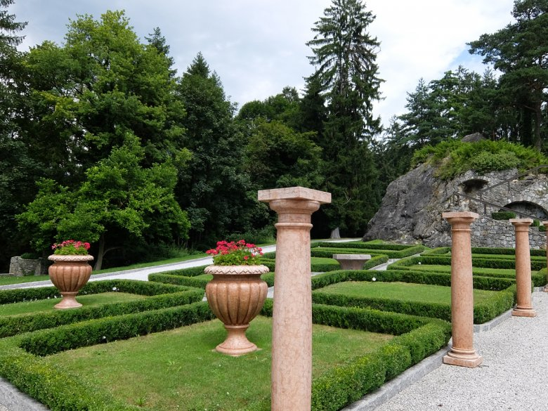 The castle sits majestically amid sprawling acres of manicured gardens and grounds.