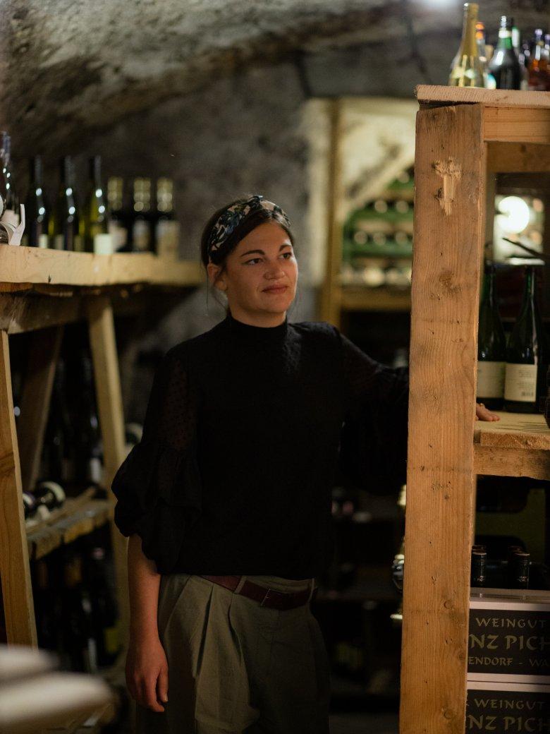 Sabrina Steindl in the wine cellar of the Unterwirt. , © Tirol Werbung / Nicolas Hafele