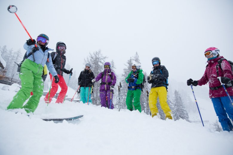 Geli teaches the group avalanche safety practices.