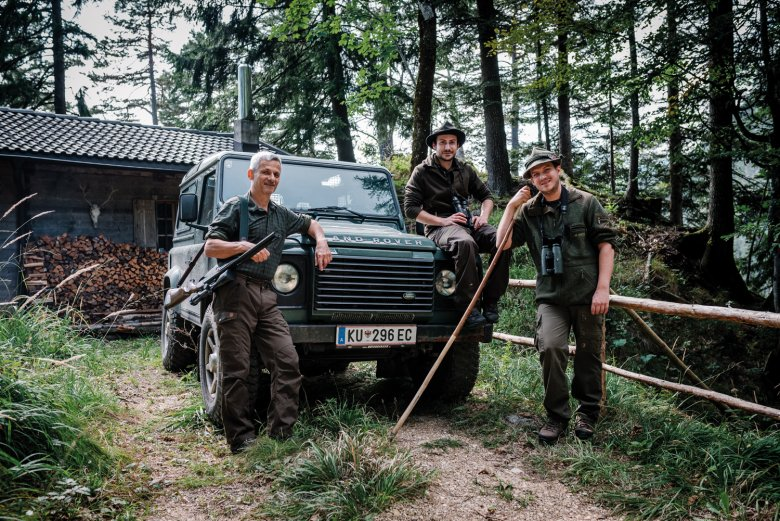 Christian and Lukas Moigg with sous-chef Simon in front of their hunting lodge.