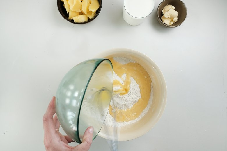 Add these eggs to the other mixture and mix carefully.