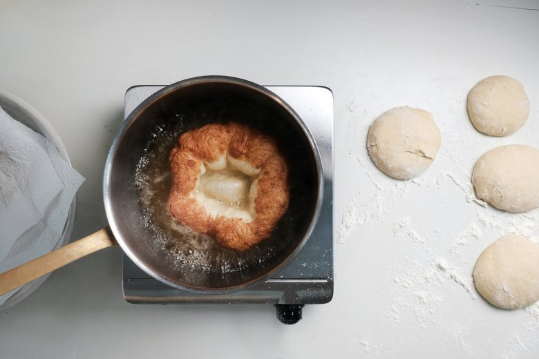 Warm the clarified butter without making it too hot. Add each Kiachl one by one and cook until golden brown.