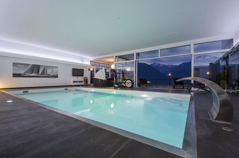 Stunning mountain vistas, contemporary furnishings and a private indoor pool. Is there anything else you could possibly ask for?