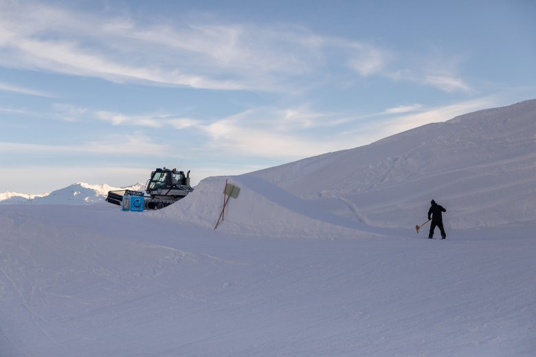 The shaping crew puts the finishing touches on a jump.