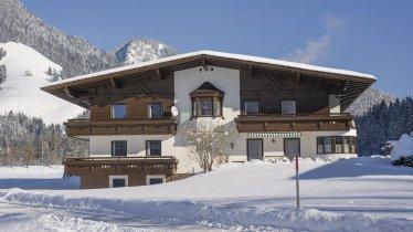 Appartementhaus Walchsee im Winter