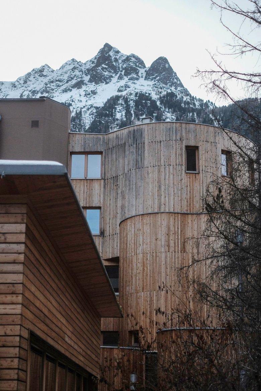 The Naturhotel Waldklause boasts an impressive wooden facade.