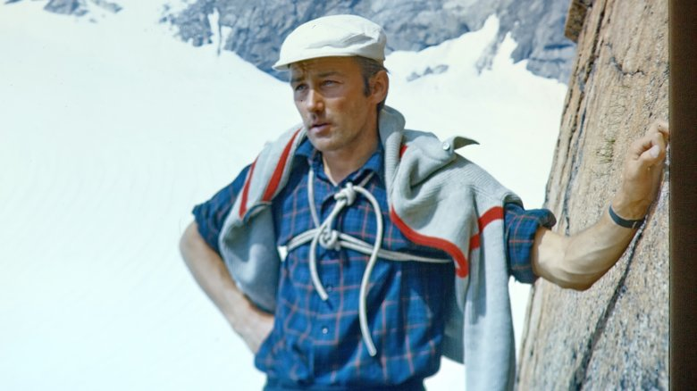Typical hiking and climbing attire at the time.