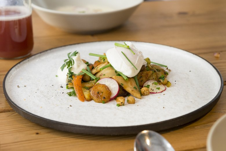 Serve the poached egg on your Vegetable Groestl.