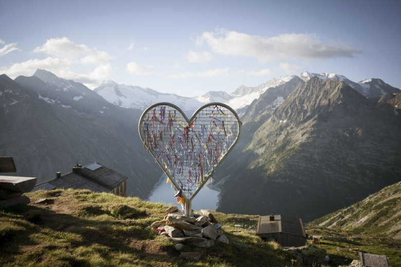 Olperer Hut in Zillertal Valley offers incredible views of mountain peaks and a glinting lake