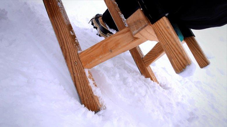 To brake, press both feet into the snow next to the skids.