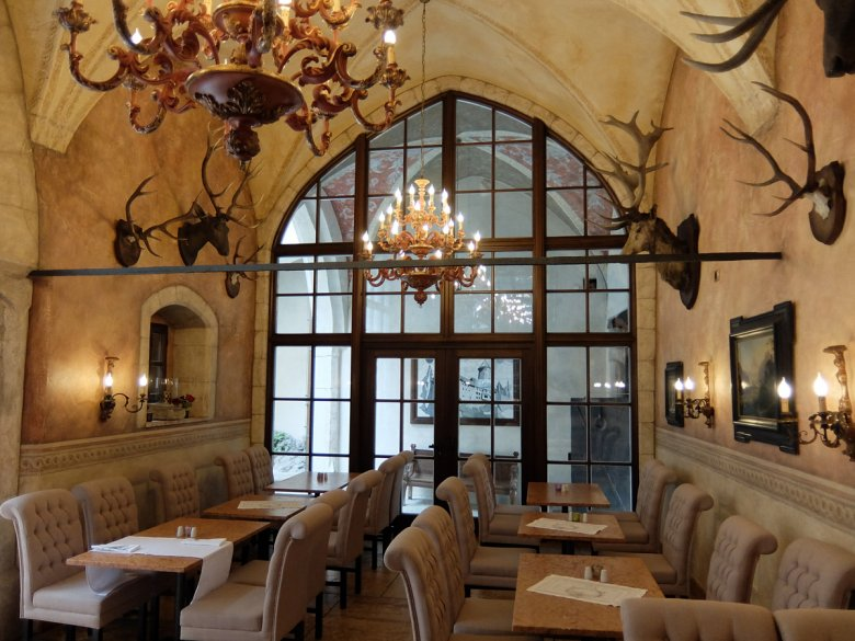 Richly decorated with antlers, the breakfast room is to die for.