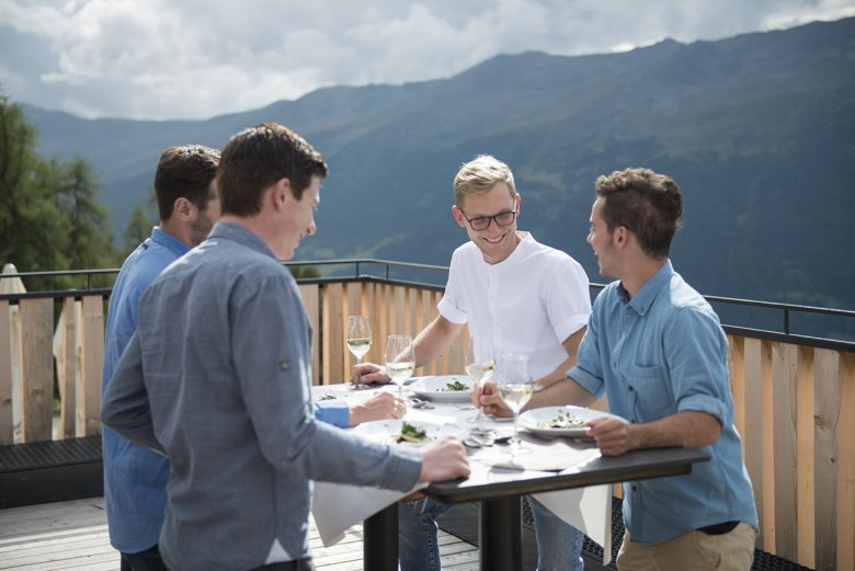 The delicious food is enjoyed together at Stieralm Alpine Pasture Hut, high above Nauders.