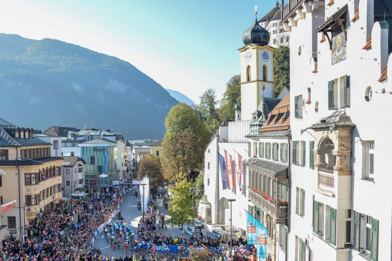 The world's best riders were rolling out of Kufstein's picturesque historic old town border under sunny autumn skies.