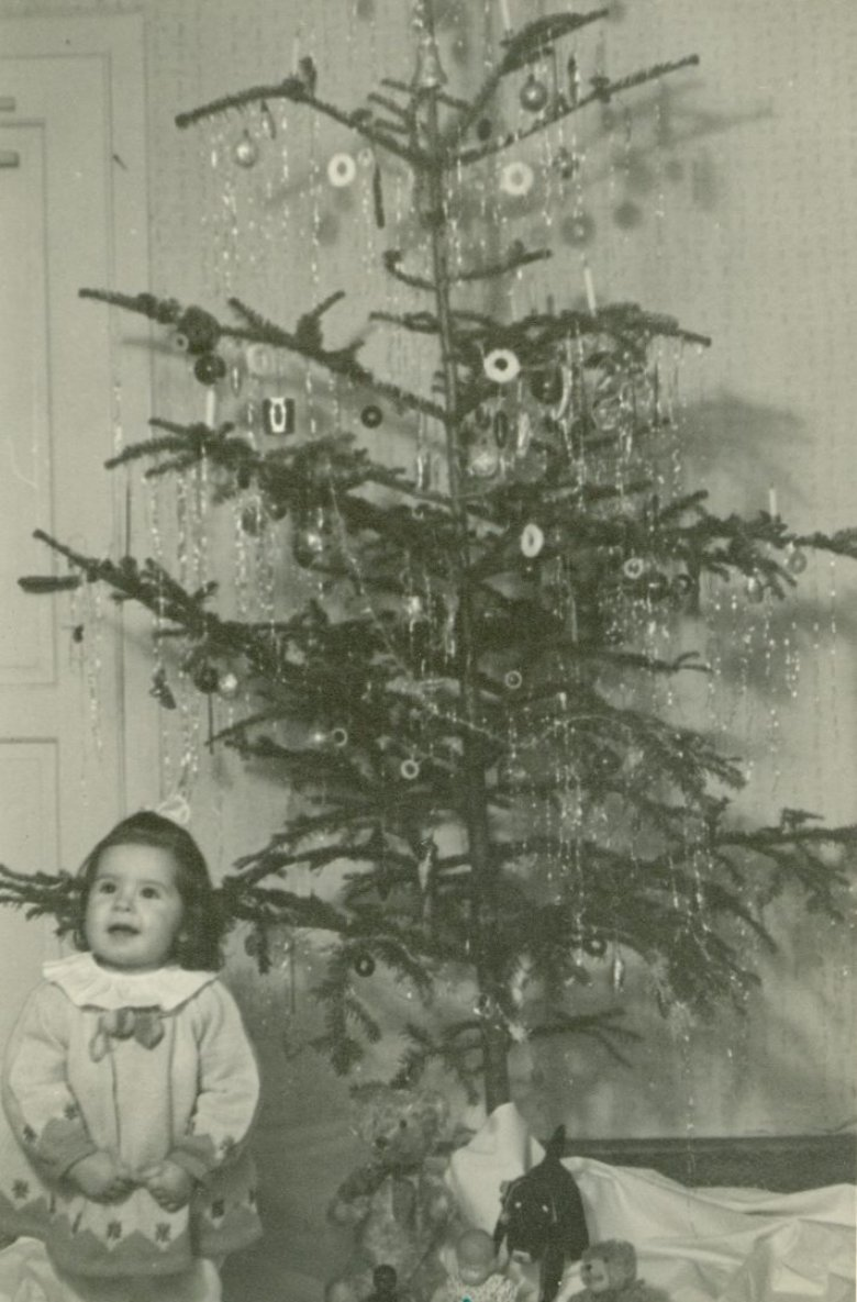 Some things never change: Christmas presents and a happy recipient, 1950. Copyright: Ferdinandeum Innsbruck