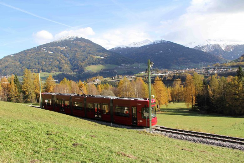 The Tram winds and turns and zigzags and goes through rolling green meadows on its way to Fulpmes in Stubaital Valley. Pictured in the rear is snow-flecked Patscherkofel, the iconic mountain in Innsbruck's backyard. (Copyright: Haisjackl)