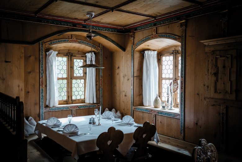 The wood-panelled dining room was installed during extensive renovation work under Christian Moigg.