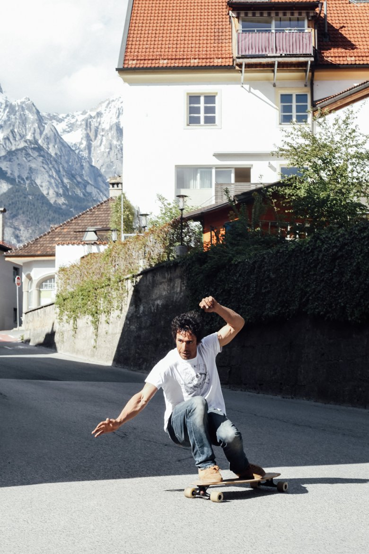 Benoît test rides a homemade longboard.