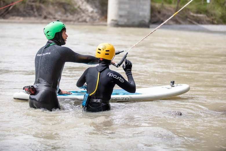 The surf coach helps beginners to get comfortable with the waves and the river.