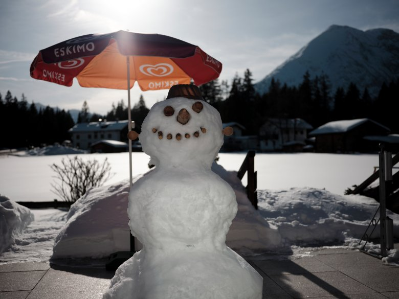 Snowmen like to keep cool in the shade, but a little warm sunshine is actually needed to create the kind of soft snow ideal for making a good snowman.