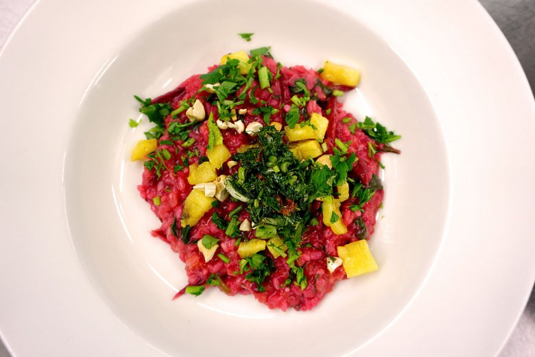 Their red beet risotto is a standout with its salsa verde, grilled pineapple and roasted cashews. Photo Credit: Olive