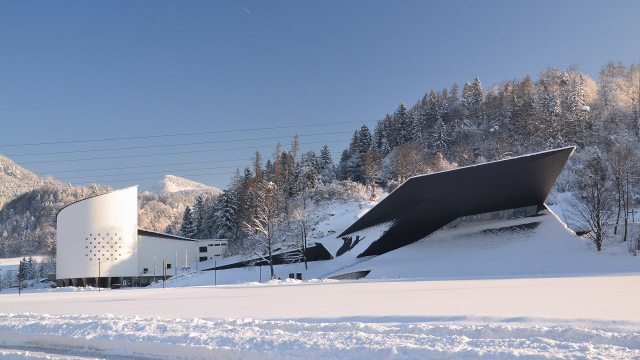 The new Festspielhaus (right) and the traditional Passionsspielhaus in Erl, © Peter Kitzbichler