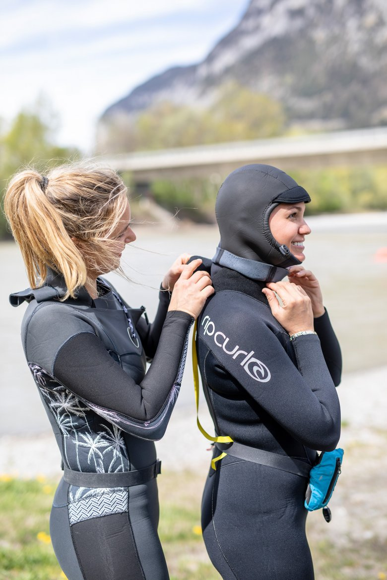The Inn River surfers wear thick wetsuits that keep them warm in the freezing cold water.