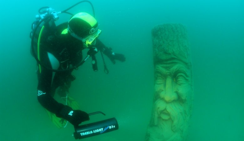 This submerged carved figure provides an underwater adventure in Lake Urisee. (Photo Credit: TVB Lechtal-Reutte)