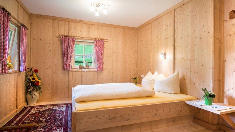 Bedroom, Ferienhaus Stillupp, © Huetten.com
