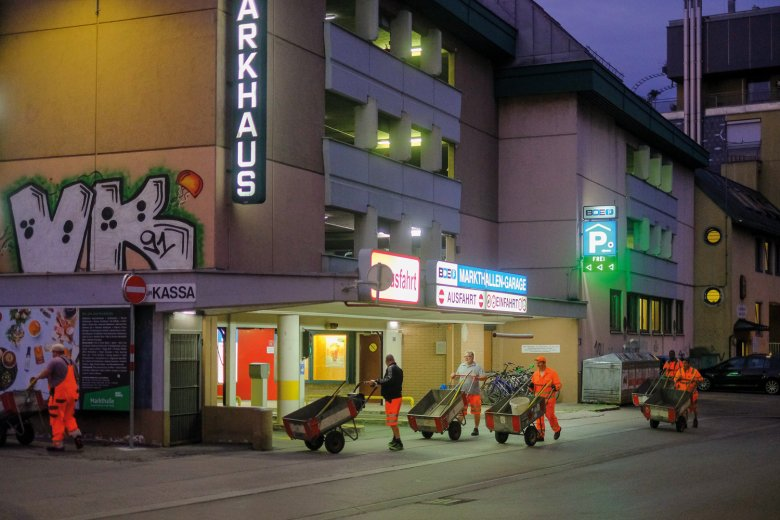 5.40 A.M. While most of the city sleeps, Innsbruck's street-cleaning team heads back to base for a well-deserved rest.