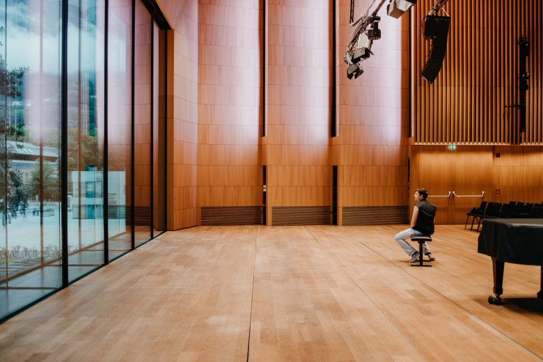 Paul gazes out of the glass front in the Haus der Musik. Its main concert hall has outstanding acoustic properties.