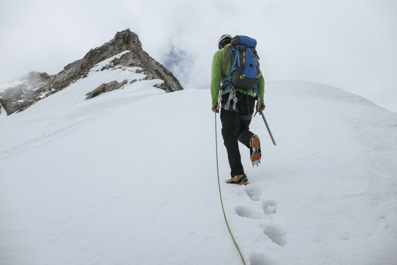"""Bernhard nears the summit ridge. """"A few days ago I had to cancel a tour atop Olperer because of avalanche danger,"""" says Bernhard."""
