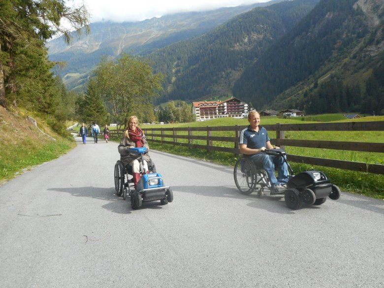 With SwissTrac, the powerful 'tractor' for wheelchairs, Eelke and Tim can overcome natural obstacles independently. The powered wheelchair pully devices are available for rental from Weisseespitze Hotel in Kaunertal Valley.