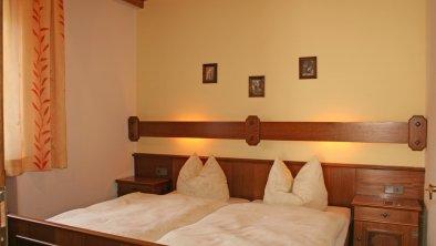 Schlafzimmer in einer der Ferienwohnungen