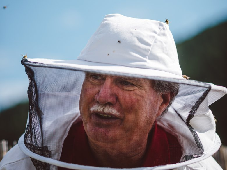 Reinhard Hetzenauer with his protective beekeeper's hat. His grandfather originally sparked his interest in beekeeping.