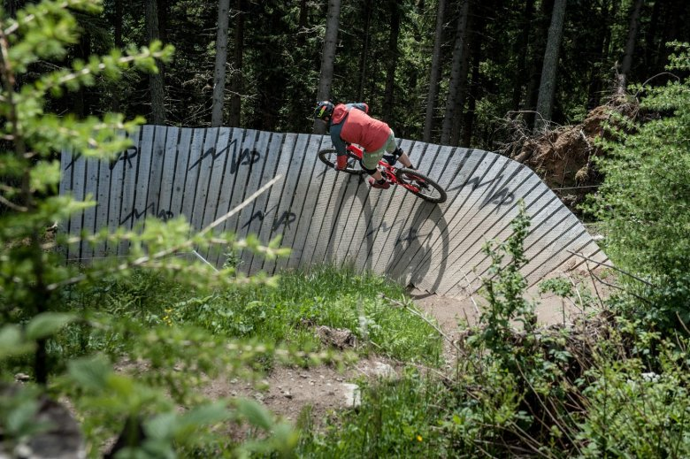 """One of the two wall-rides in the upper section of the trail""""The First One""""."""