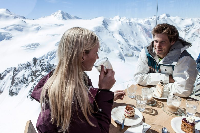 Enjoying a delicious cake and drinking in the jaw-dropping scenery at an elevation of 3,400 meters above sea level (Photo Credit: Daniel Zangerl)
