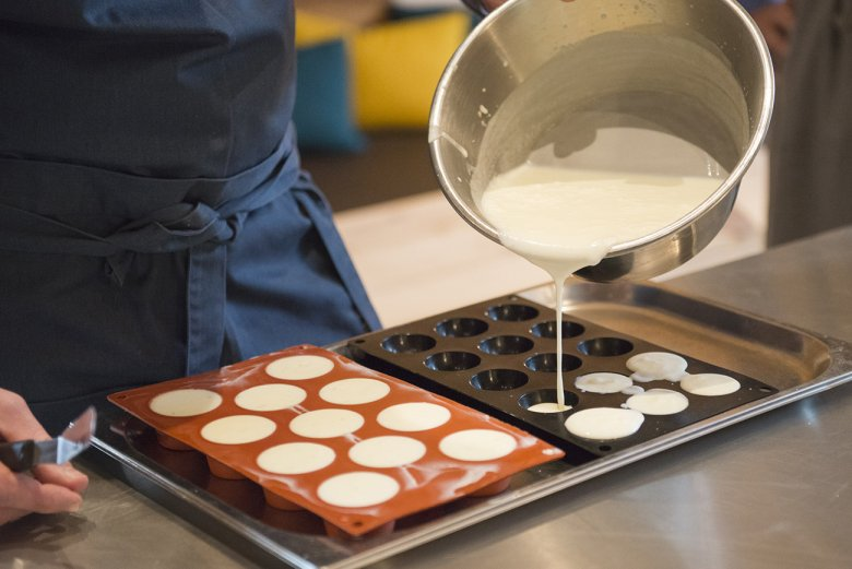 The mousse is poured into molds and chilled in the refrigerator until set.